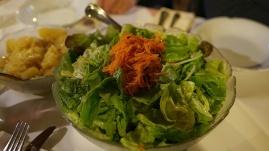 Sharing bowl of green salad