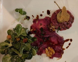 Deer tartar and carpaccio on field salad.